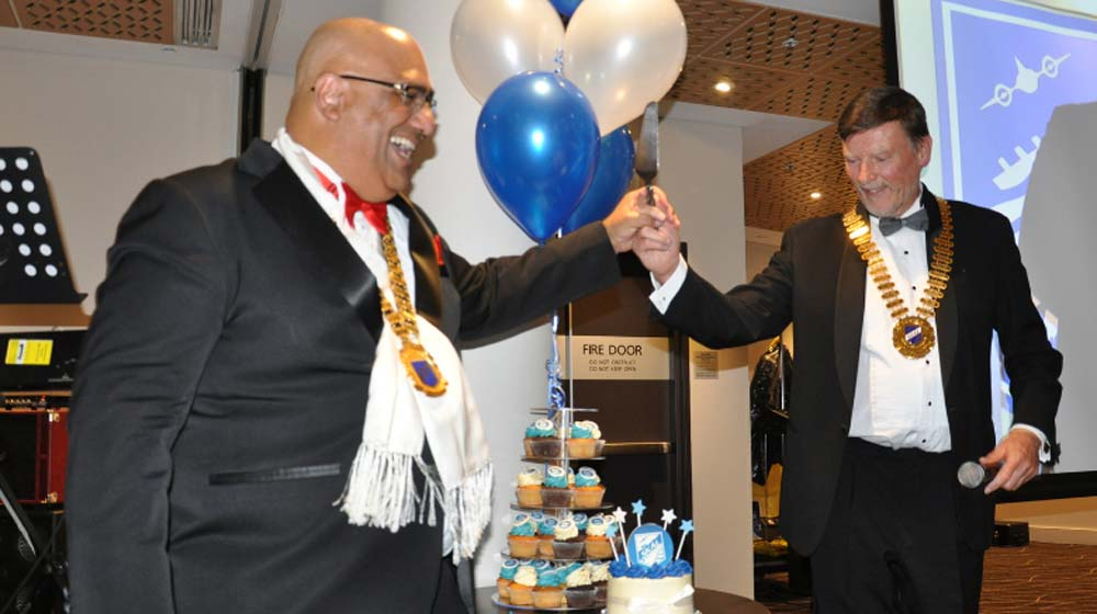 Walter Nand and Alfred Merse cake cutting