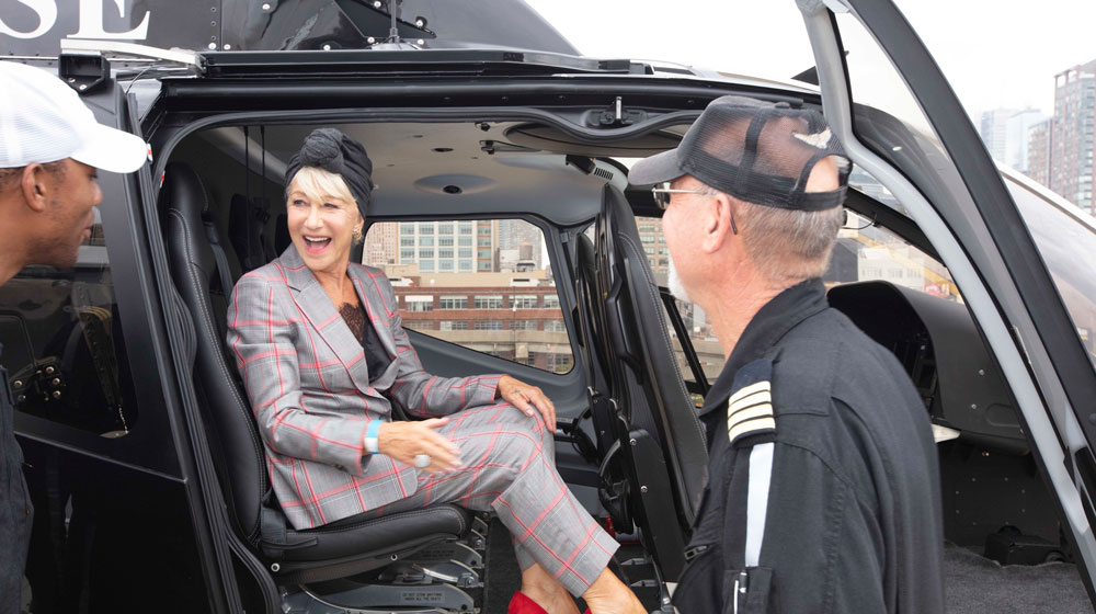 Dame Helen Mirren, Scenic Eclipse's godmother, aboard one of the ship's two helicopters